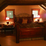 Upstairs bedroom with sitting area in Log Cabin