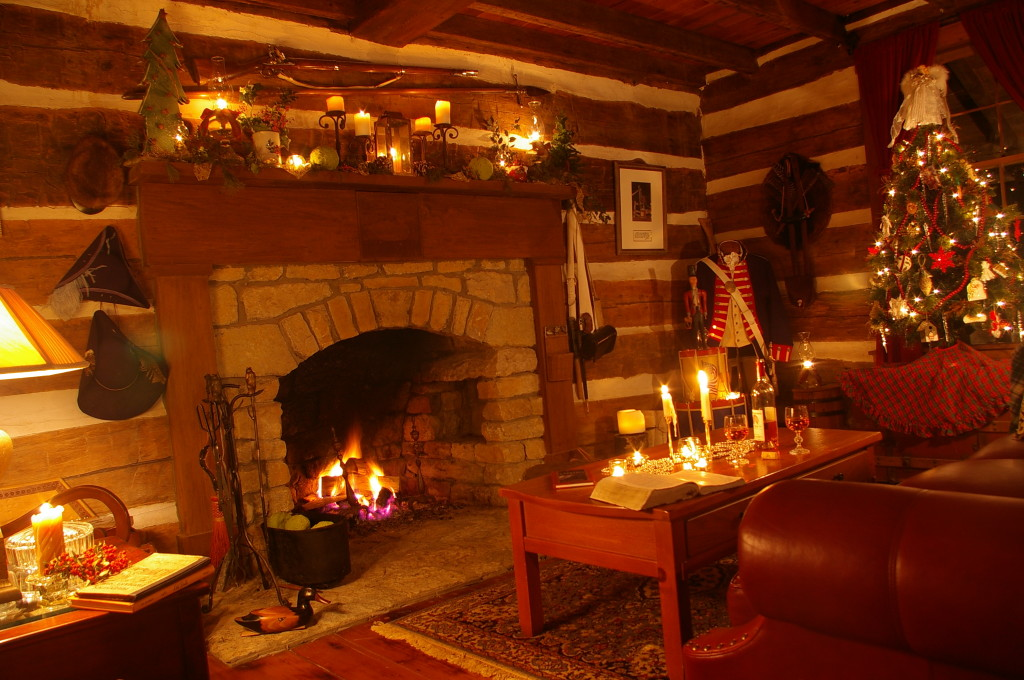 Wine and candlelight in front of stone fireplace